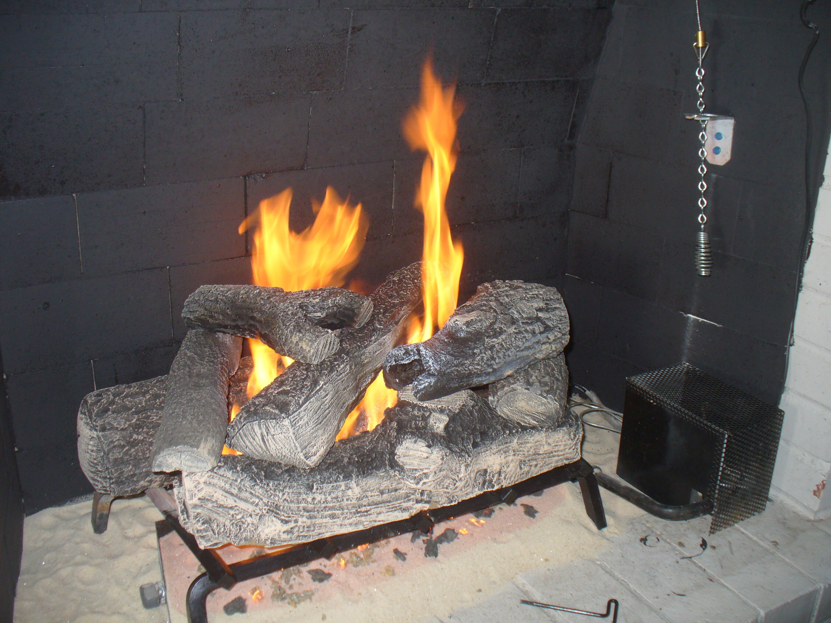 INSTALL GAS FIREPLACE LOGS – Fireplaces